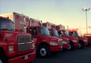 fleet of Coca Cola diesel trucks